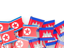 Flag pins of North Korea DPRK and Cambodia isolated on white Stock Photo