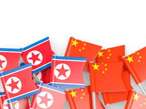 Flag pins of North Korea DPRK and China isolated on white Royalty Free Stock Photo