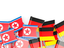 Flag pins of North Korea DPRK and Germany isolated on white Royalty Free Stock Photos