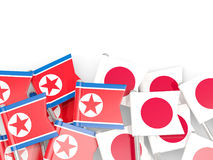 Flag pins of North Korea DPRK and Japan isolated on white Royalty Free Stock Images