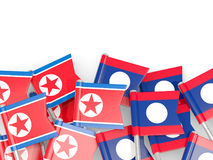 Flag pins of North Korea DPRK and Laos isolated on white Royalty Free Stock Photography