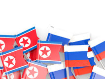Flag pins of North Korea DPRK and Russia isolated on white Royalty Free Stock Photography
