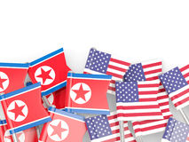 Flag pins of North Korea DPRK and USA isolated on white Stock Images
