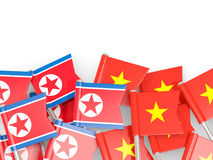 Flag pins of North Korea DPRK and Vietnam isolated on white Royalty Free Stock Images