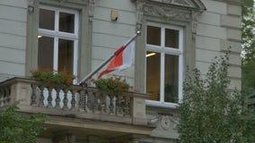 Flag of Poland on Balcony. The flag of Poland on a balcony of a building stock footage