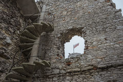 Flag of Poland seen through a window of a ruined castle in misty weather. May be good for keying flags on royalty free stock photography