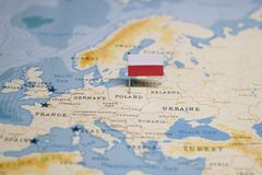 The Flag of poland in the world map.  stock photos