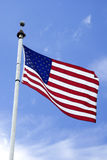 Flag on a Pole. An american flag on a tall pole Stock Photo