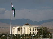 Flag pole in Dushanbe, Tajikistan. A 165-meter-high flagpole hoisting Tajikistan's three-color flag, measuring 60 meters by 30 meters, in front of the newly Royalty Free Stock Photography