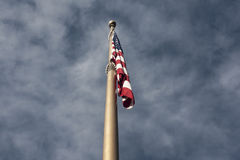 Flag On Pole. Upwards view of US flag on flagpole royalty free stock photography