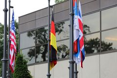 Flag Poles. With Several International Flags Royalty Free Stock Photo