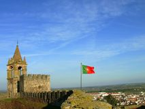 Flag Of Portugal. Flying from castle in mourão alentejo portugal stock photo