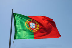 Flag of Portugal. Against blue sky stock images
