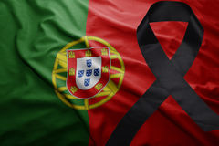 Flag of portugal with black mourning ribbon Royalty Free Stock Photo
