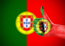 Flag of Portugal on hand. National flag of Portugal on hand Stock Photo