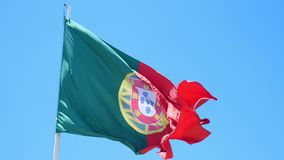 Flag Portugal wind. Isolate flag of Portugal on a flagpole fluttering stock footage