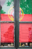 The Flag of Portugal in window in Faro city Stock Photo