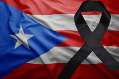 Flag of puerto rico with black mourning ribbon Stock Photos
