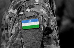 Flag of Puntland State of Somalia on soldiers arm. Puntland Stat. E of Somalia flag on military uniform. Army, troops, Africa collage royalty free stock photos