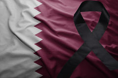 Flag of qatar with black mourning ribbon. Waving national flag of qatar with black mourning ribbon Stock Images