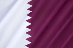 Flag of Qatar. National flag and ensign of Qatar - The flag was officially adopted on July 9, 1971, although a nearly identical flag (only differing in Royalty Free Stock Images