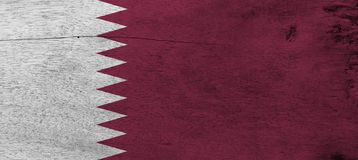 Flag of Qatar on wooden plate background. Grunge Qatari flag texture. Flag of Qatar on wooden plate background. Grunge Qatari flag texture, a white band on the royalty free stock photography
