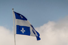 Flag. A Quebec flag on pole Royalty Free Stock Images