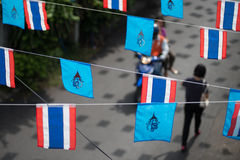 Flag of Queen Sirikit decorated above street in Bangkok, Thailand. Stock Image