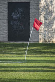 Flag. Red, corner flag on a soccer pitch Stock Image