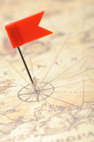 Flag red a pin on old map Royalty Free Stock Photo