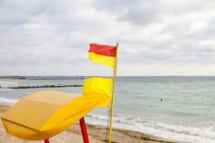 Flag red-yellow of lifeguards on the Black Sea coast Stock Images
