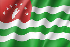 Flag of Republic of Abkhazia. Waving flag of Republic of Abkhazia. Patriotic national sign, horizontal stripes in green and white, open hand on a red field Stock Photography