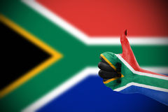 Flag of Republic of Republic of South Africa on hand. Flag of Republic of South Africa on female's hand, defocused flag in background Stock Photography