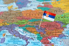 Serbia map and flag pin. Flag of the republic of Serbia on map. It is a landlocked country situated at the crossroads of Central and Southeast Europe Royalty Free Stock Images