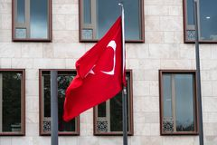 Flag of the Republic of Turkey. Berlin, Germany - October 25, 2018: Turkish Flag waving outside the Embassy of Turkey in Berlin royalty free stock image