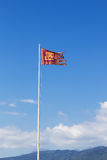 Flag of the republic of venice waves in the wind on a tall pole Royalty Free Stock Image