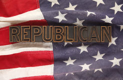 Flag with Republican word. The word Republican in letterpress wood type on an old American flag Stock Photo