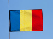Flag of Romania in the wind against a sky Royalty Free Stock Images