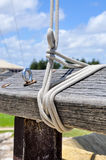 Flag Ropes on Wooden post Stock Photography