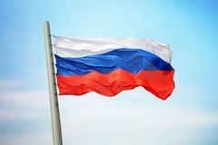 Russian flag. Flag of Russia against the background of the sky Stock Photography