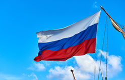 Flag of Russia. Against blue sky Royalty Free Stock Images
