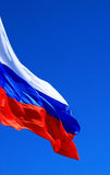 Flag of the Russia. Against blue sky Stock Photos