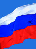 Flag of the Russia. Against blue sky Stock Photo