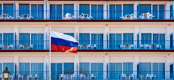 Flag of Russia. Against hotel balconies Royalty Free Stock Images