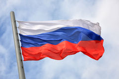 Flag of Russia. Against the sky Royalty Free Stock Images