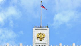 The flag of Russia and The coat of arms of Russia on the top of The House of the Government of the Russian Federation. UHD - 4K. The flag of Russia and The coat stock footage