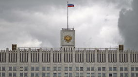 The flag of Russia and The coat of arms of the Russian Federation on the top of The House of the Government stock video footage