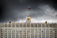 The flag of Russia and The coat of arms of the Russian Federation on the top of The House of the Government of the Russia Stock Image