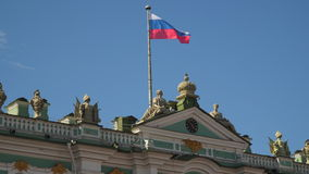 Flag of Russia on the facade of the Winter Palace in St. Petersburg stock footage