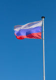 Flag of Russia. Fluttering on wind against the sky Royalty Free Stock Photography